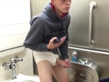 Handsome Young Stud Caught Masturbating In Public Bathroom